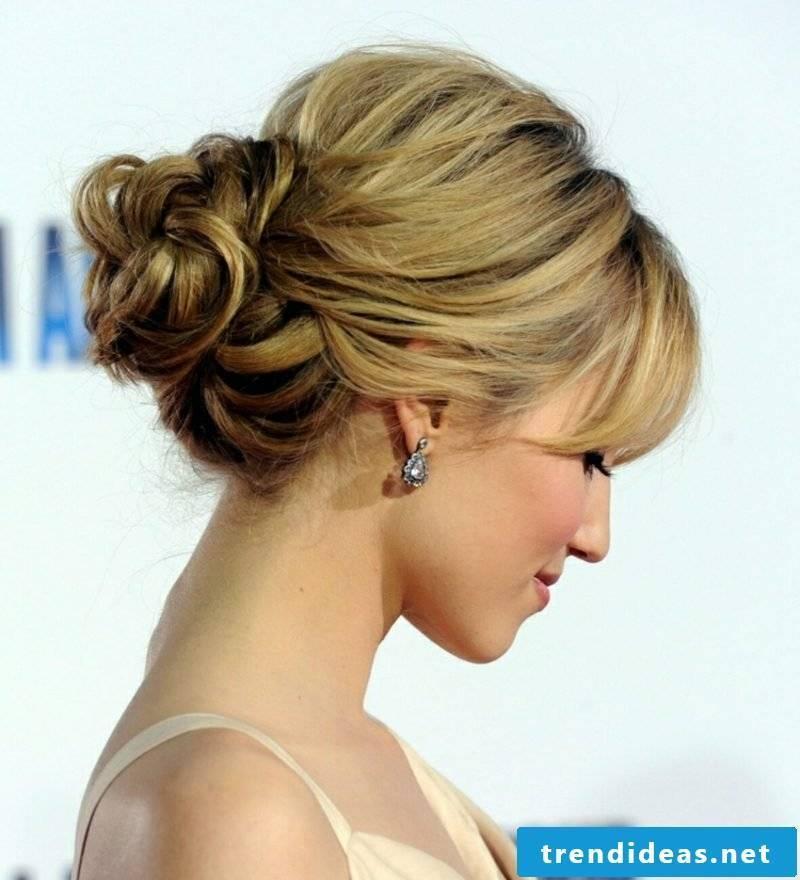 long hair with bangs elegant bun hairstyle