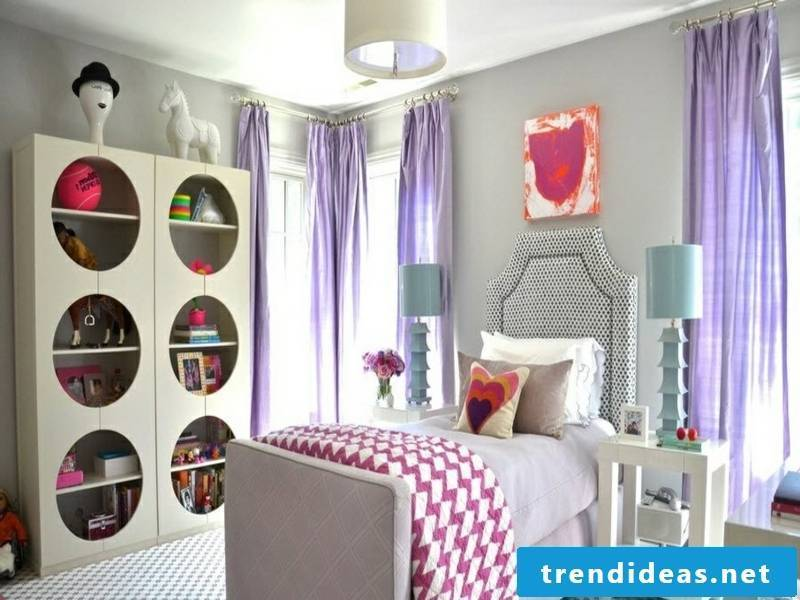 modern children's room for girls with purple window curtains