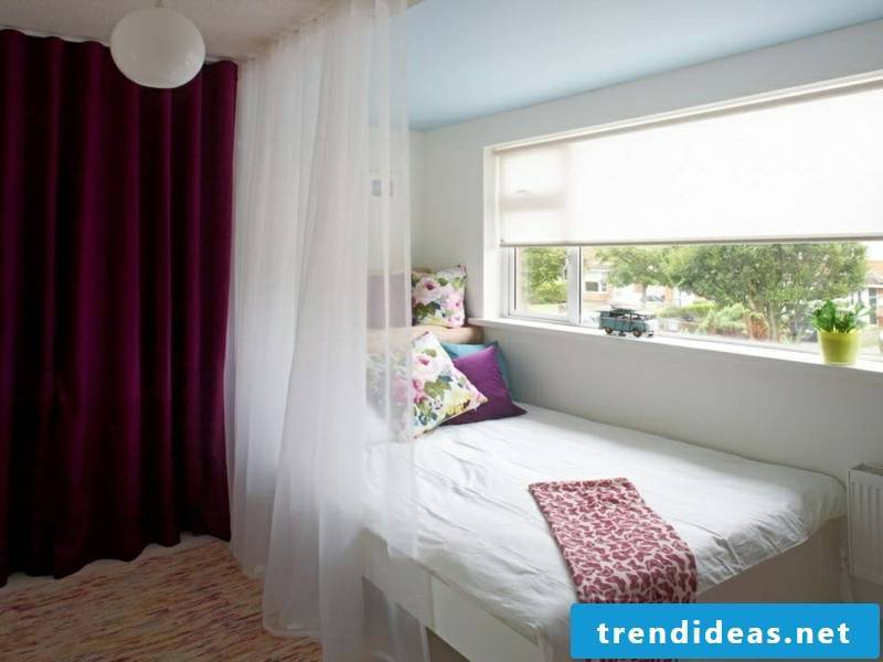 designer purple window curtains in teenage bedroom
