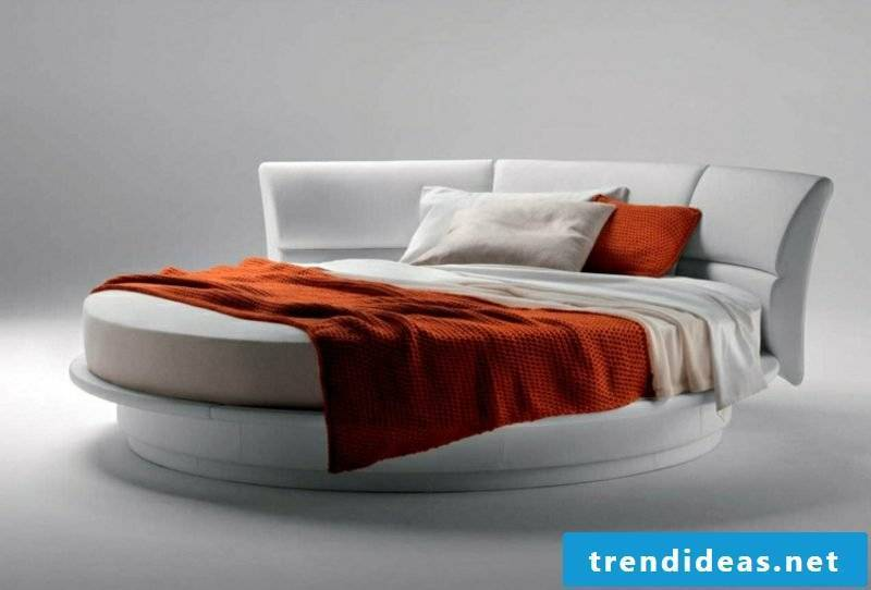 round bed upholstered in white comfortable