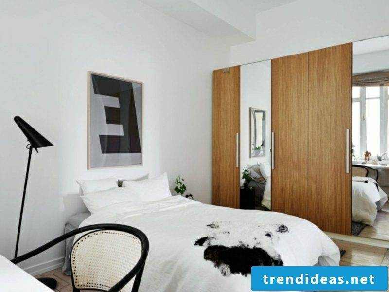 Scandinavian furniture Bedroom wardrobe made of oak wood as an accent in the interior