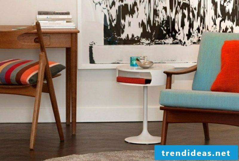 Scandinavian furniture armchair light blue upholstery white table wood floor