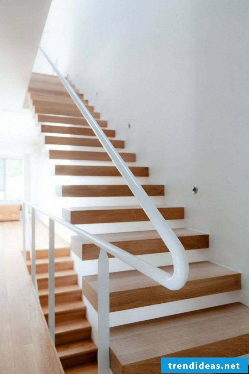 free-hanging staircase with white handrail