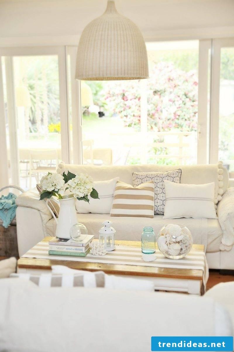 Furnish the living room with a Hussensofa Scandinavian