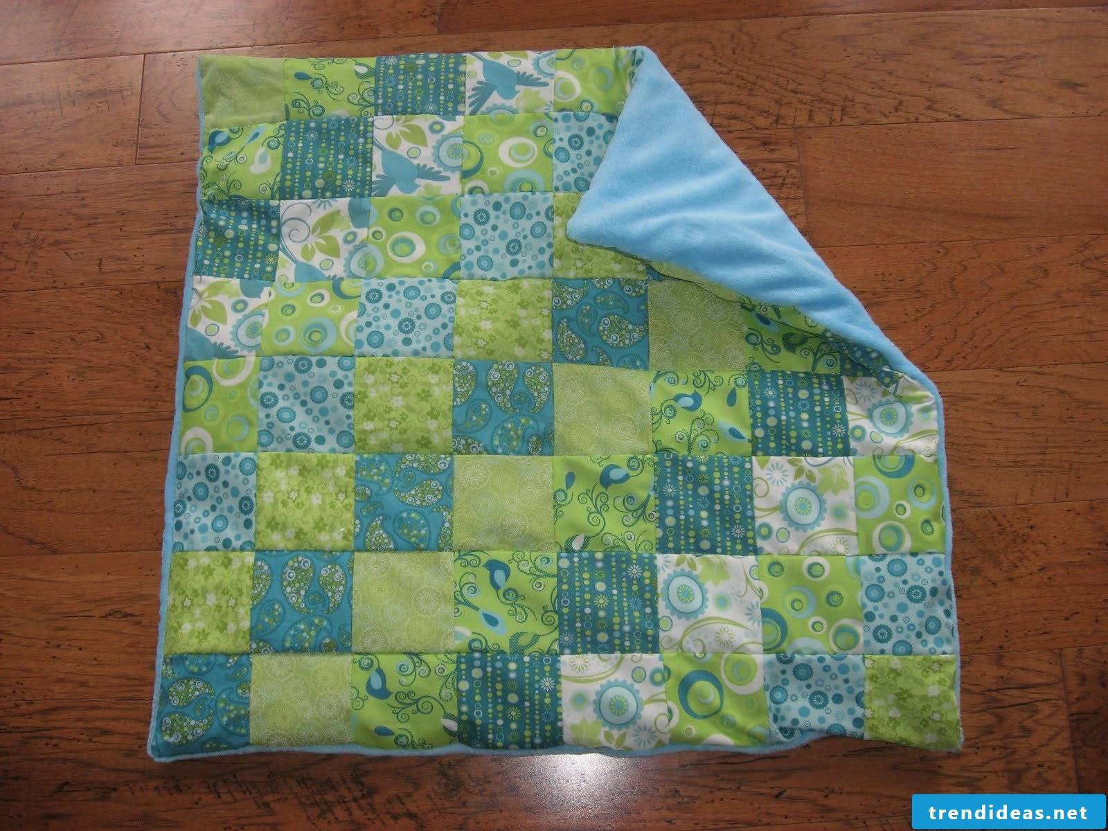 Patschwork baby blanket in green and blue