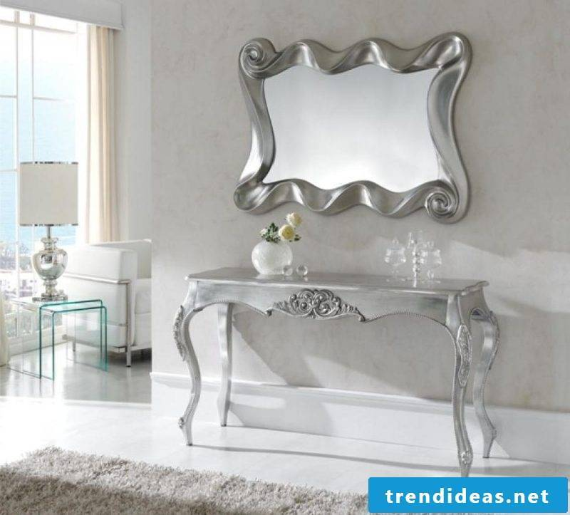 A silver console table.
