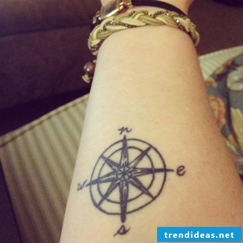 small tattoo motives compass forearm