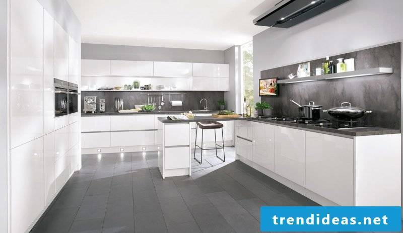 Gray splash guard for kitchen in a white kitchen