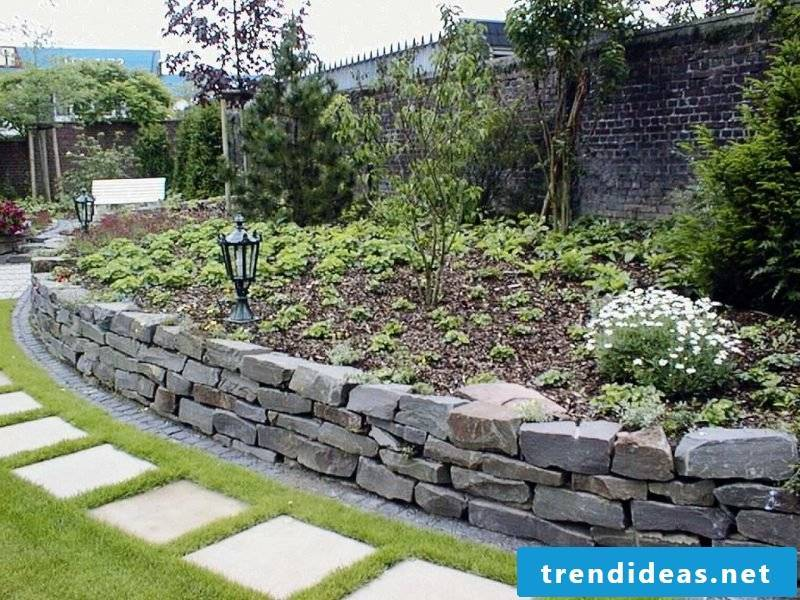 Stone wall in the garden low bed border