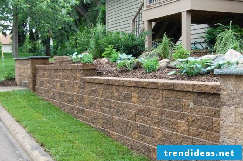 Stone wall in the garden apron border