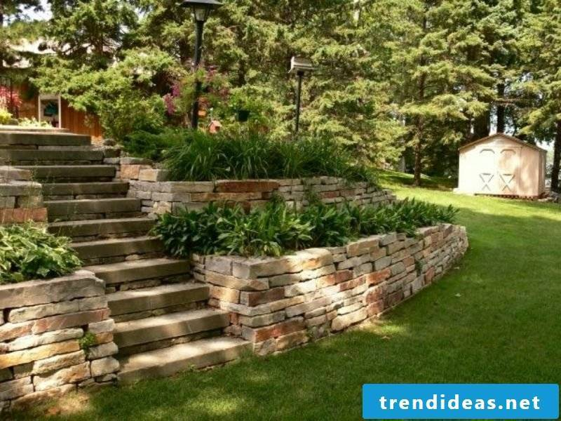 Stone wall garden flowerbeds stairs