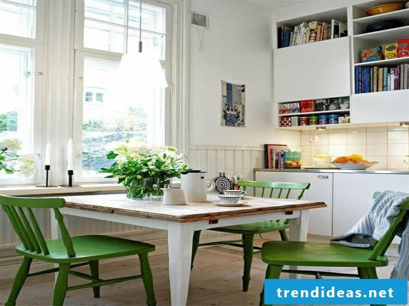 white kitchen table and green chairs