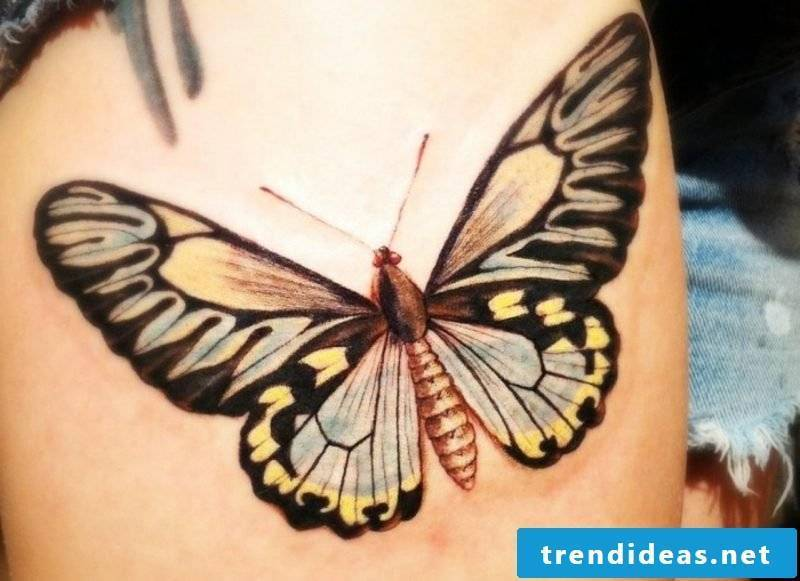 Tattoo butterfly big colored upper arm