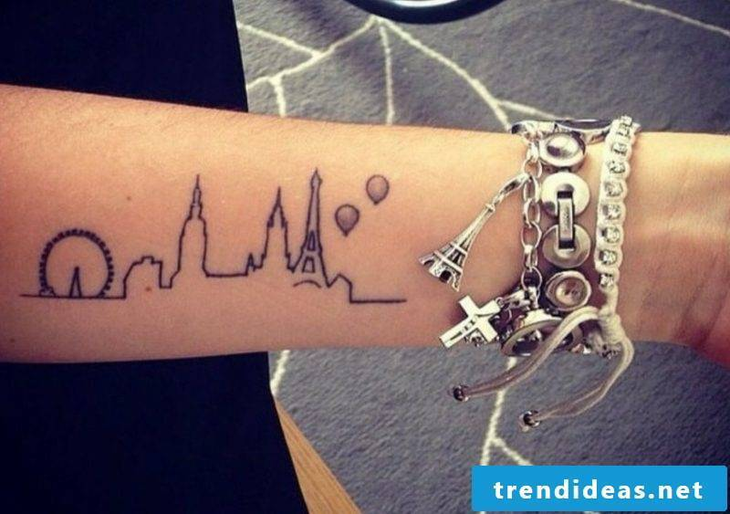 Tattoo on forearm silhouette city woman gorgeous look