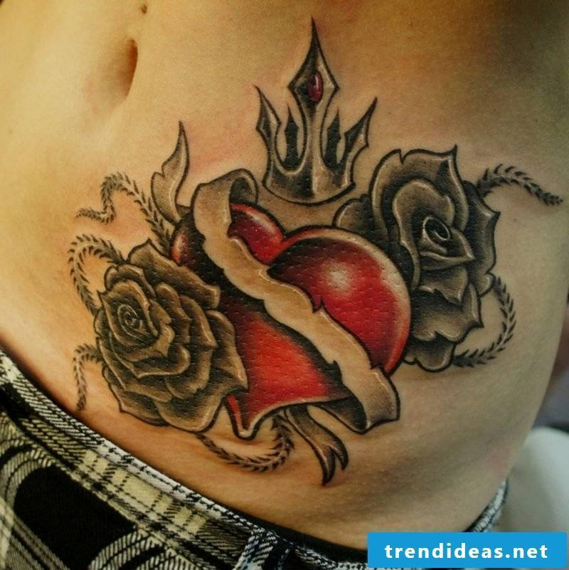 red heart and black roses tattoo on the belly