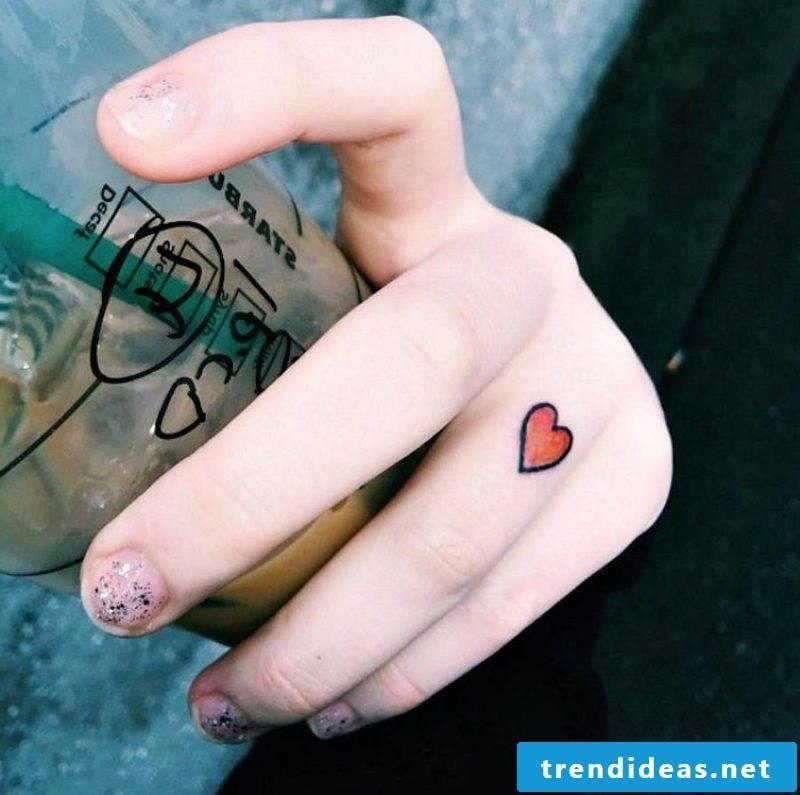 Finger tattoo heart motif