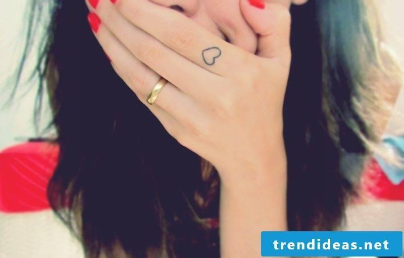 Finger tattoo heart
