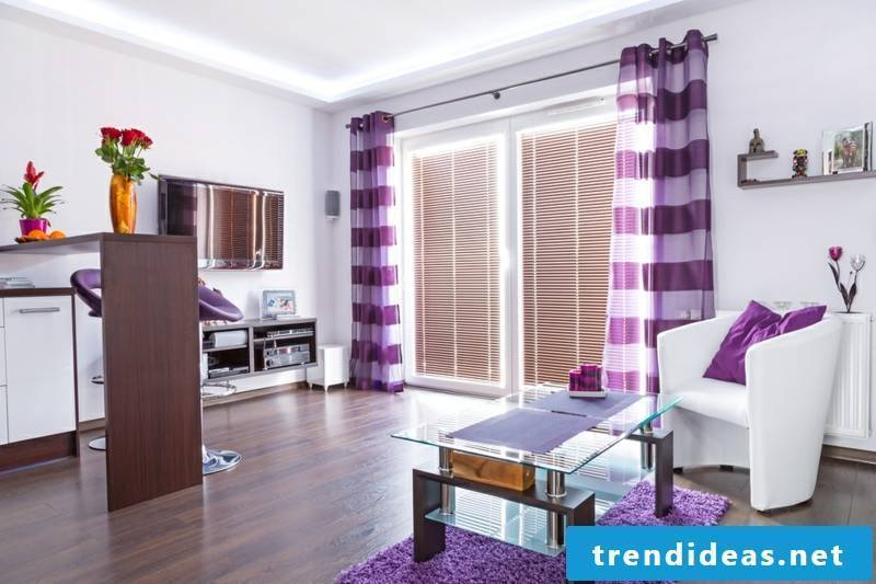 Living room with original purple curtains