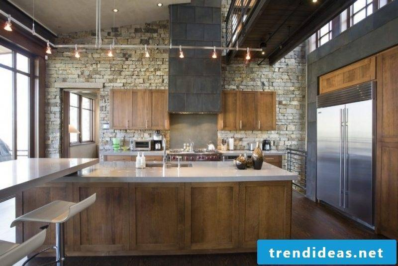 Combine wall panels with stone look with wood in the kitchen