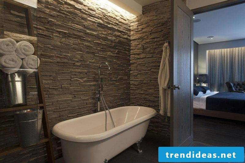 Choose wall panels with stone look for the wall with the bathtub