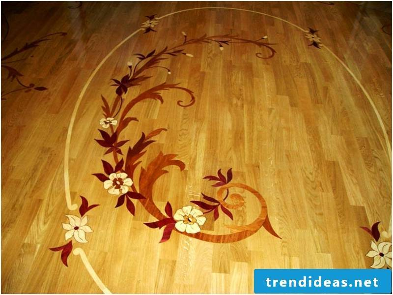 Parquet floor with a small flower decoration