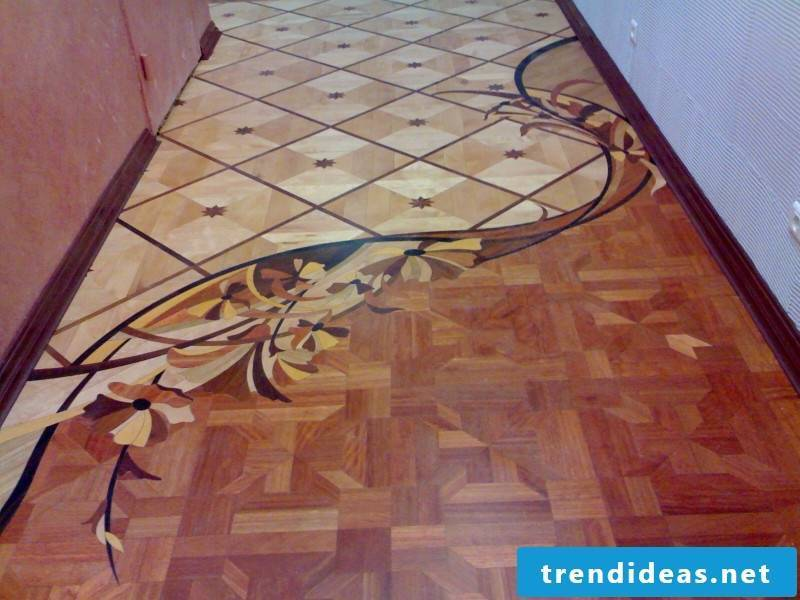 three different parquet decorations on a floor