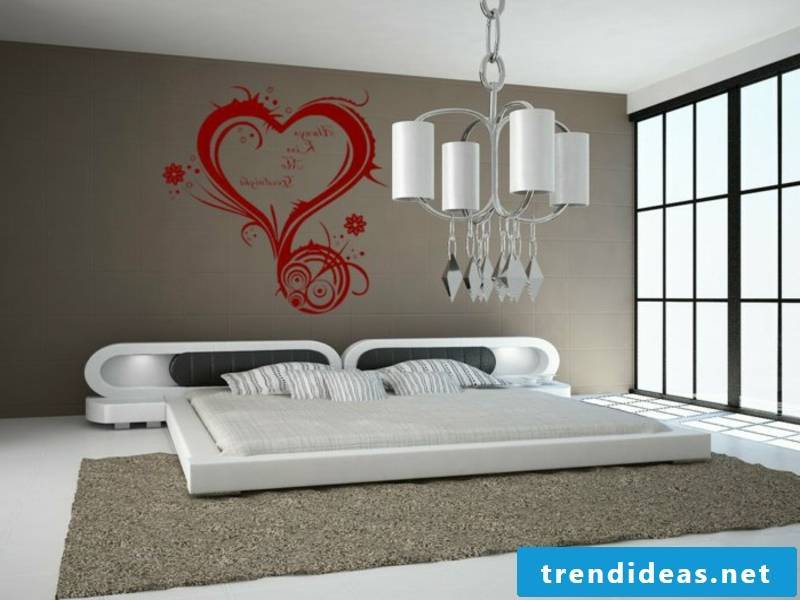 white bed in the bedroom with red accent