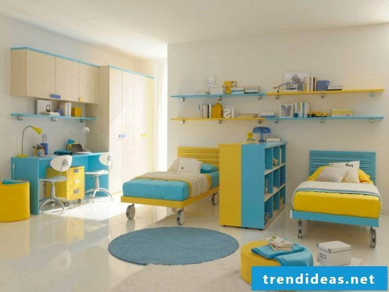 white walls and blue-yellow accents in the nursery