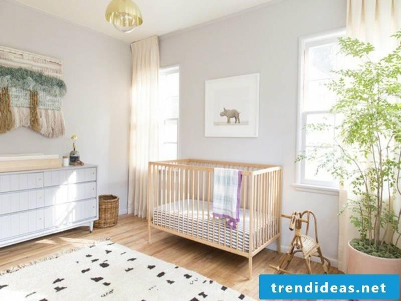 designer white color scheme in the nursery
