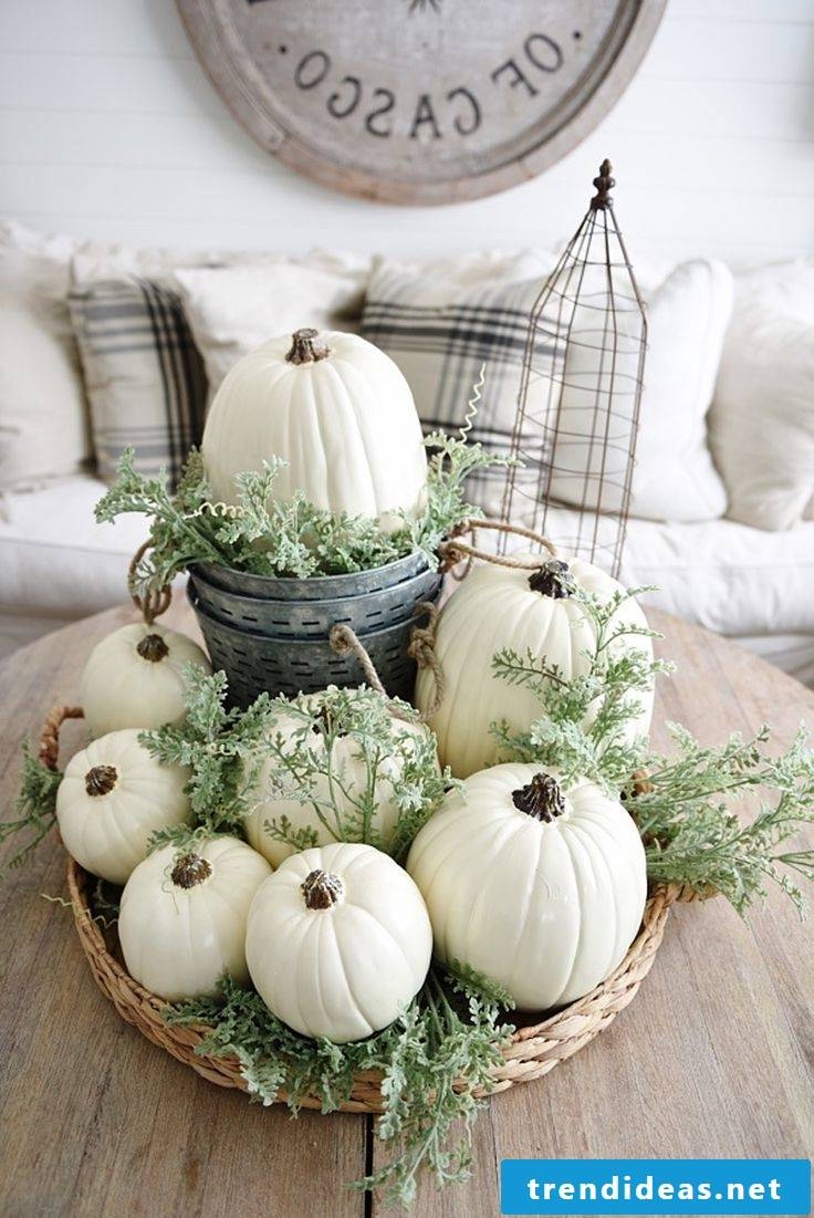 Autumn table decoration with white pumpkins