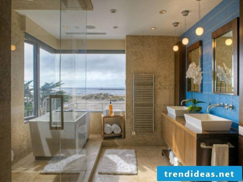 beautiful modene bathroom lighting in front of the blue wall