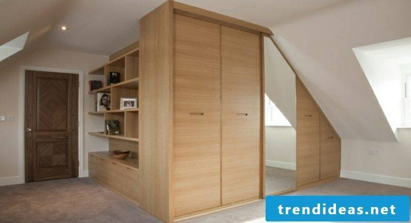 modern walk-in closet with mirror sloping roof