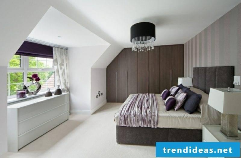 modern walk-in closet in dark wood sloping roof