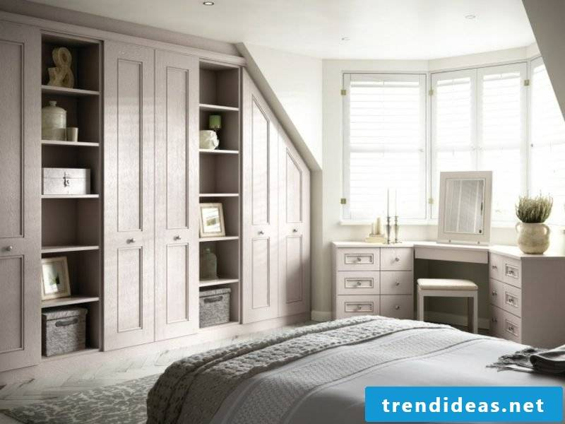 walk-in closet under sloping roof classic look