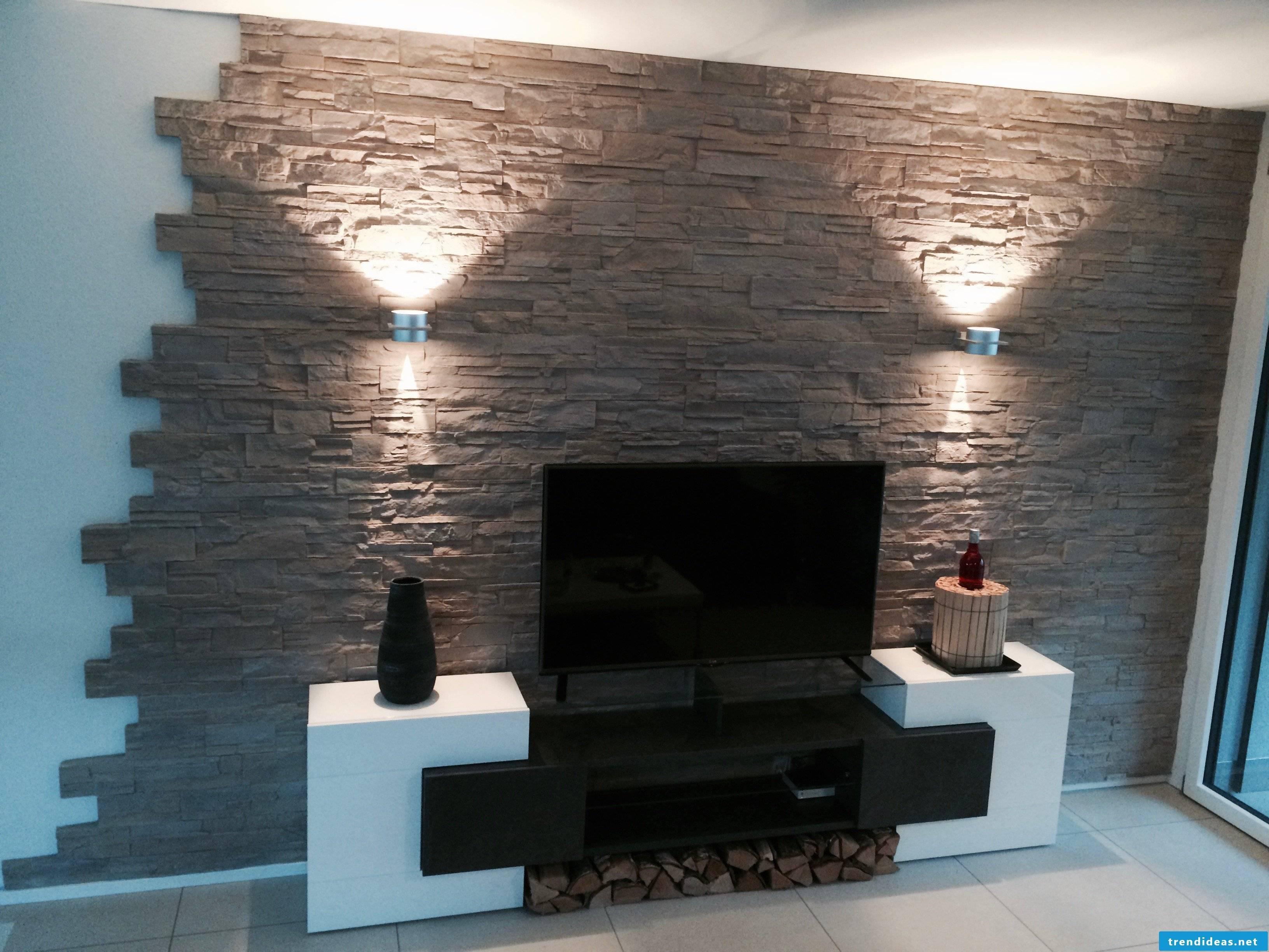 Illuminated decorative wall with stone cladding