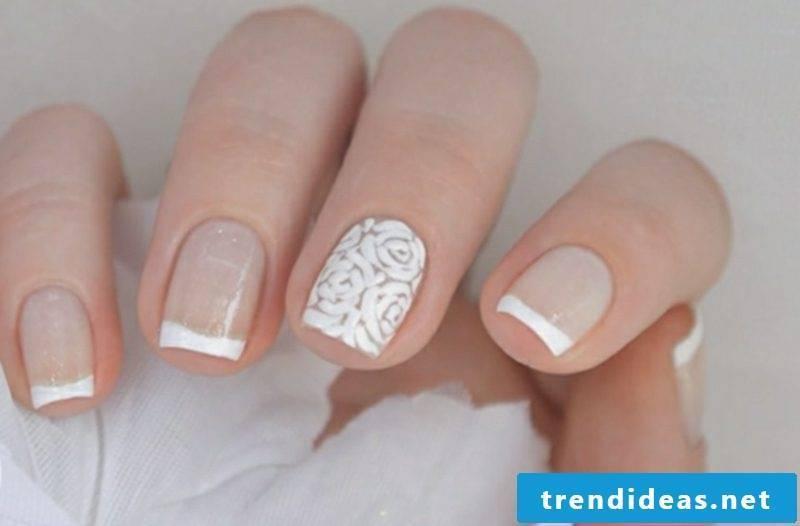 Fingernails design French wedding translucent nail polish flowers accent middle finger
