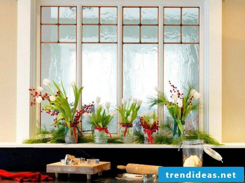 Christmas decoration windowsill white tulips red berries