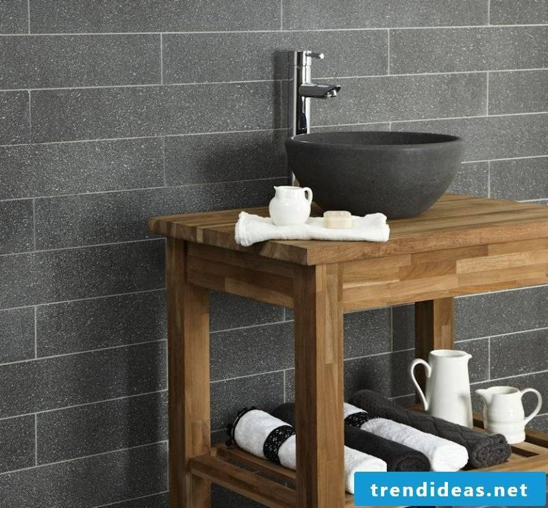 wood vanity top in combination with black stone sink