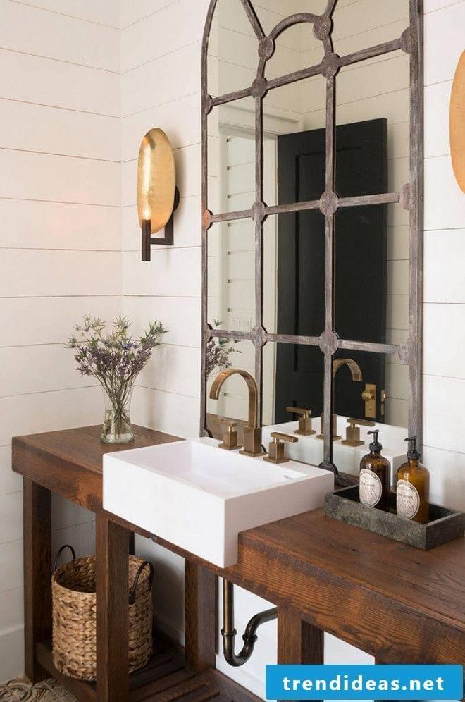 wood vanity top in a rustic bathroom decorated with lavander brings comfort