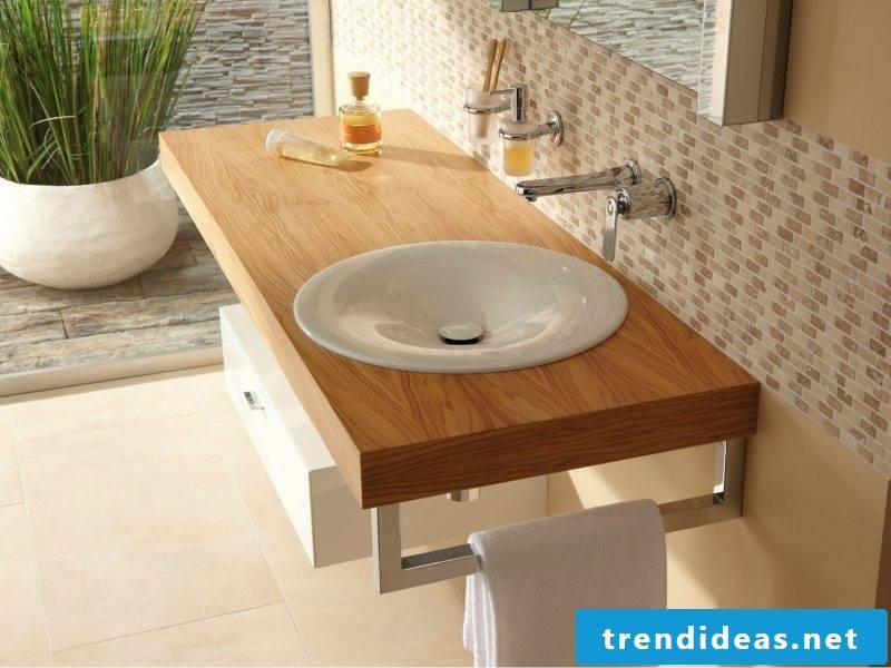 Wood vanity top gives visual enhancement in the bathroom
