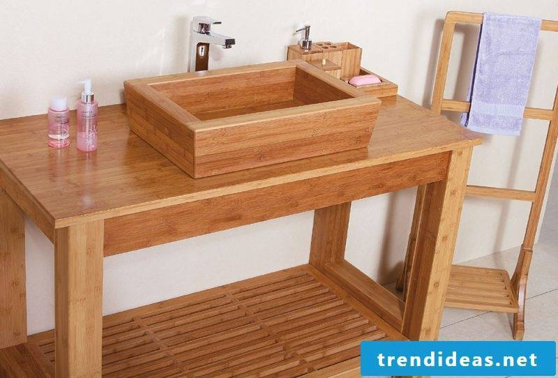 Well maintained wood vanity top with small storage space underneath