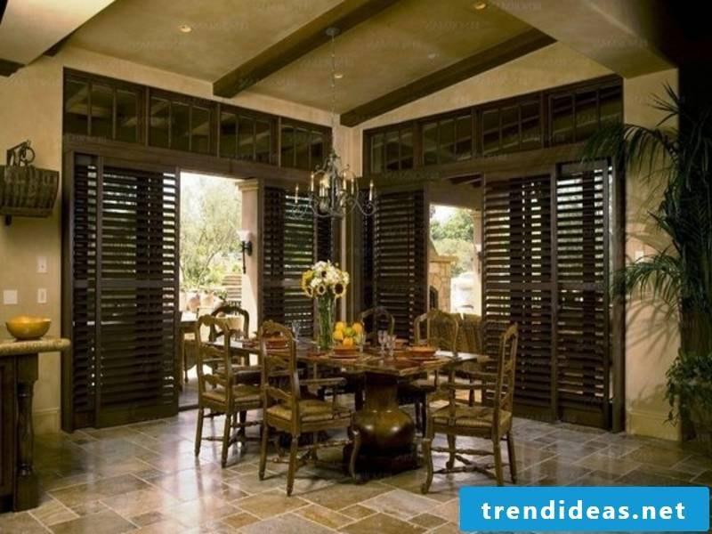 Chic dining room with wooden blinds