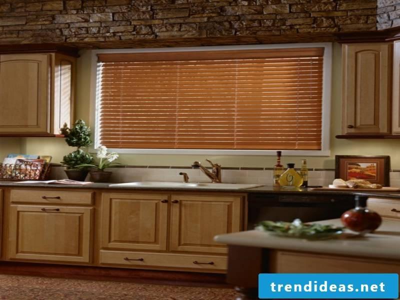Elegant kitchen with wooden blinds