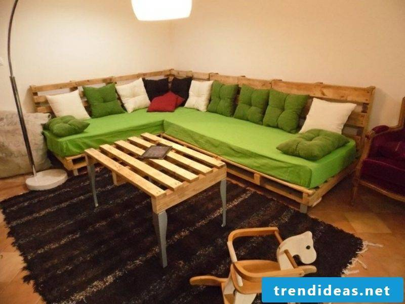 Pallet sofa long self built coffee table made of pallets